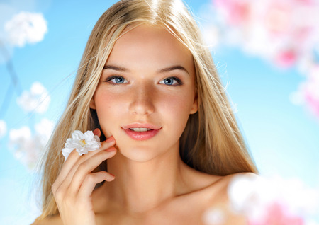 Beautiful girl with spring flowers. Beauty & Skin care. Spring.
