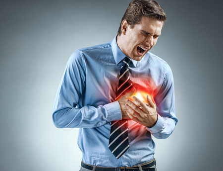 Office manager holding hands on painful chest. Medical concept. Heart attack.