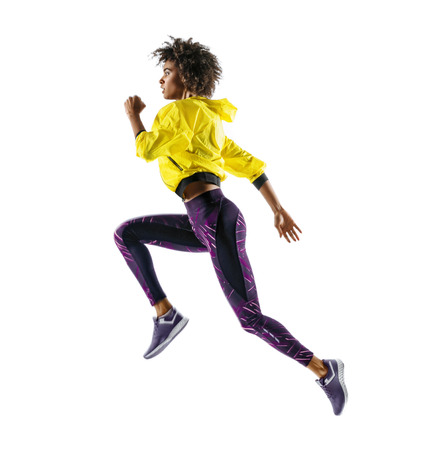 African girl runner in silhouette on white background. Dynamic movement. Side view