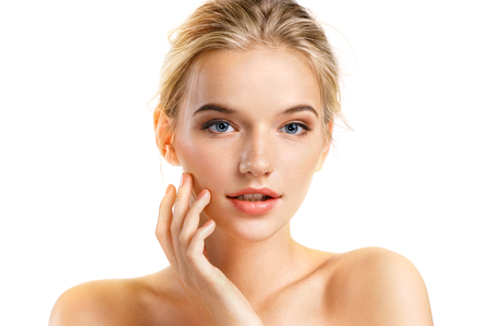 Beautiful young girl touching her face. Youth and skin care concept
