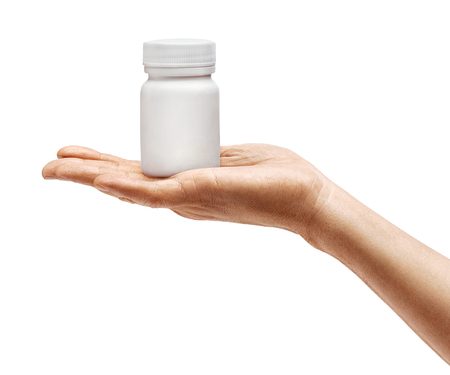 Mans hand holding medical bottle with pills isolated on white background. Palm up, close up. High resolution product