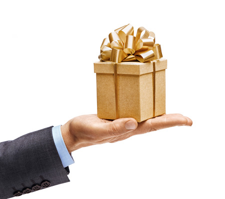Mans hand in suit holding present isolated on white background. High resolution product. Close up Stock Photo