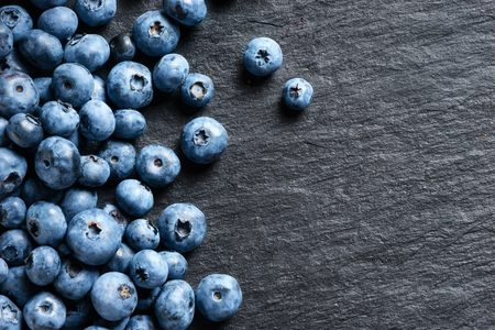 Deluxe blueberry on black slate. Copy space. Top view. High resolution product. Stock Photo