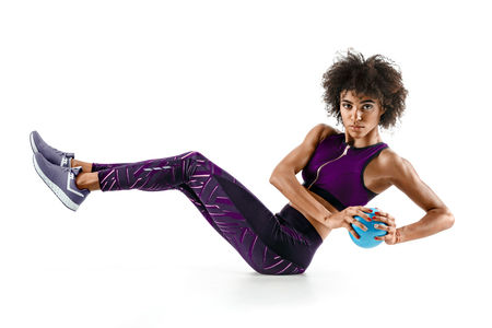 Beautiful young girl working out with fitness ball, abs. Banque d'images