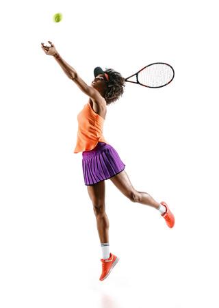 白い背景で隔離のシルエットで若いテニスの女の子。ダイナミックな動き 写真素材