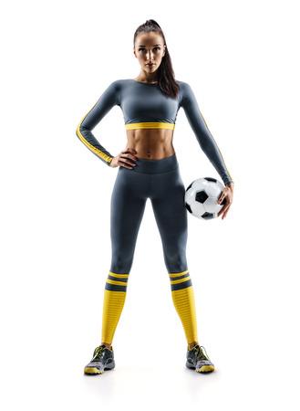Pronto a giocare. Donna del calciatore che sta nella siluetta isolata su fondo bianco. Sport e stile di vita sano Archivio Fotografico - 94472144