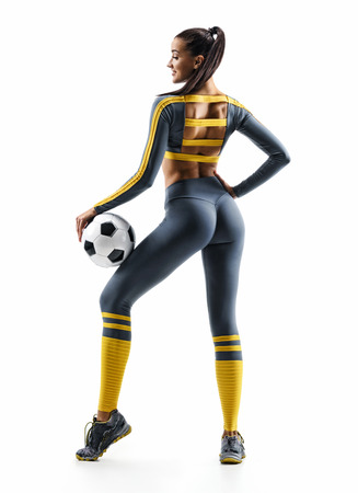 Sexual soccer player girl standing in silhouette isolated on white background. Rear view. Sport and healthy lifestyle