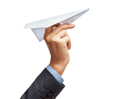 Mans hand in suit holding paper plane isolated on white background. Close up. High resolution product