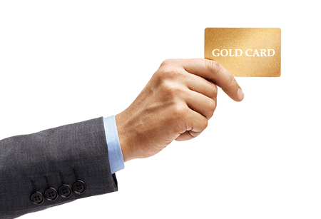 Mans hand in suit holding gold credit card isolated on white background. High resolution product. Close up. Stock Photo