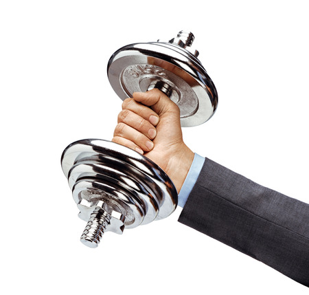Mans hand in suit holds heavy dumbbell isolated on white background. Close up. Concept of healthy lifestyle