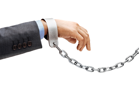 Man's hand in suit in chains isolated on white background. Close up, concept against violence Stock Photo - 95106028
