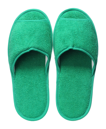 Green hotel slippers isolated on white background. Close up, high resolution