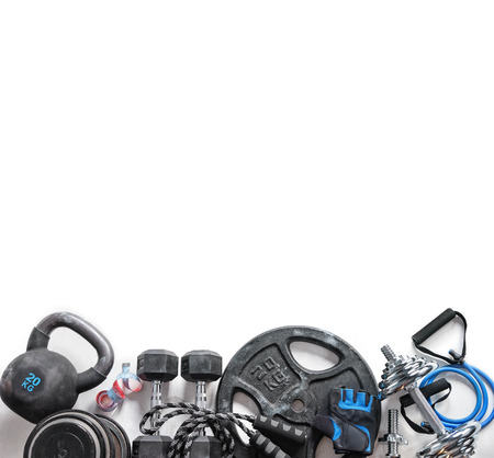 Sports equipment on a white background. Top view. Motivation. Copy space.