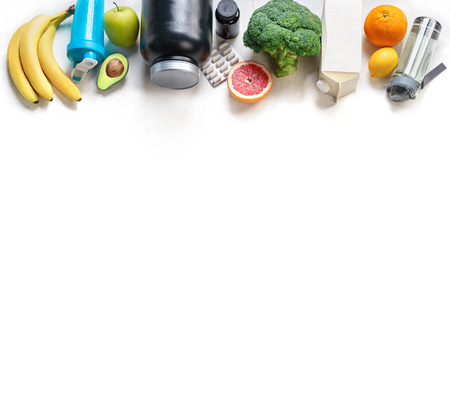 Sports nutrition on a white background. Top view. Motivation. Copy space.