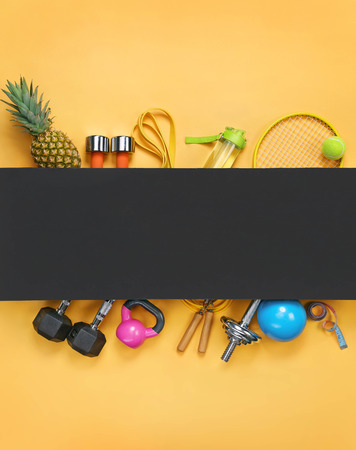 Sports equipment and organic food on yellow background. Top view. Motivation. Copy space