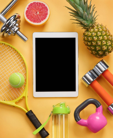 Sports equipment and organic food on yellow background. Top view. Motivation. Reklamní fotografie