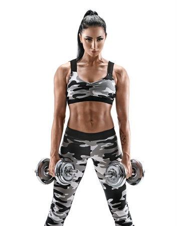 Sporty woman with dumbbells. Photo of muscular woman in military sportswear isolated on white background. Strength and motivation.