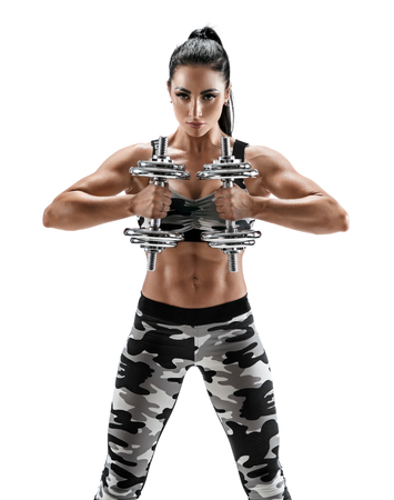 Strong woman doing exercises with dumbbells. Photo of latin woman with perfect body isolated on white background. Strength and motivation