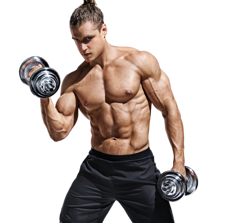 Sporttive man doing exercises with dumbbells at biceps. Photo of young man with naked torso and good physique isolated on white background. Strength and motivation. Foto de archivo