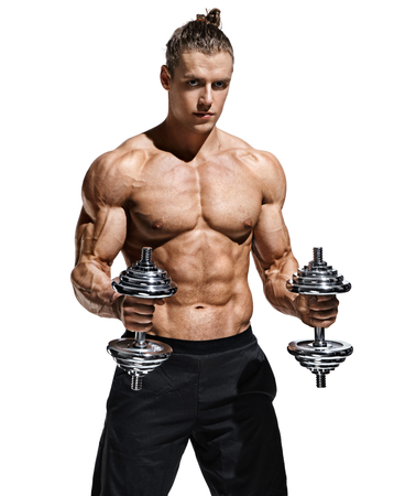 Strong man doing exercises with dumbbells at biceps. Photo of young man with good physique isolated on white background. Strength and motivation. Stock Photo