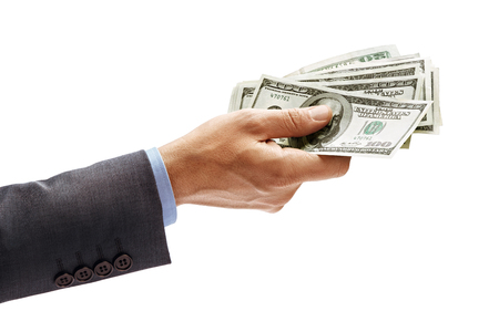 Mans hand in suit giving cash money isolated on white background. High resolution product. Close up Stock Photo