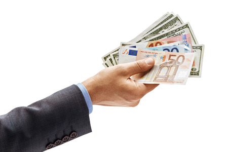 Mans hand in suit holding euro and dollars money isolated on white background. High resolution product. Close up