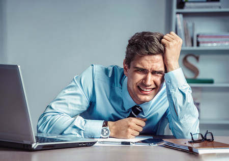 Crying man. Photo of office man with Negative facial expression at the working place, depression and crisis concept Stock Photo