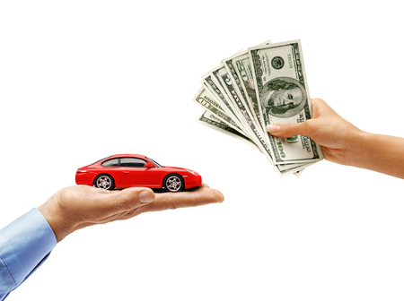 Womans hand holding money and mans hand holding red car isolated on white background. Close up. High resolution product