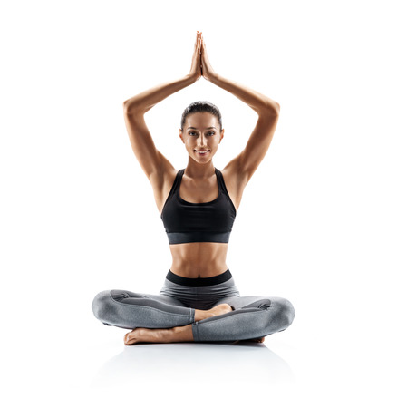 Young girl practice balance asanas isolated on white background. Concept of healthy life and natural balance between body and mental development. Full length