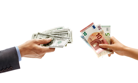 Mans hand holding dollars moneyand womans hand holding euro money isolated on white background. Close up. Currency exchange. High resolution product