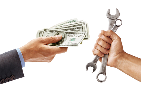 Mans hand in suit giving cash money and mans hand holding a spanners isolated on white background. Business concept. Close up. High resolution product Stock Photo
