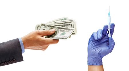 Mans hand in suit holding cash money and mans hand in medical glove with syringe isolated on white background. Medical and business concept. Close up. High resolution product Stock Photo