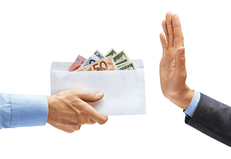 Mans hand in shirt giving full envelope of money and mans hand in suit showing stop sign isolated on white background. High resolution product. Close up
