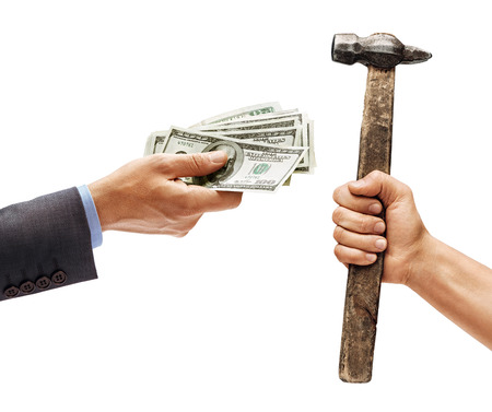 Mans hand in suit giving cash money and mans hand holding a hammer isolated on white background. Close up. High resolution product Reklamní fotografie