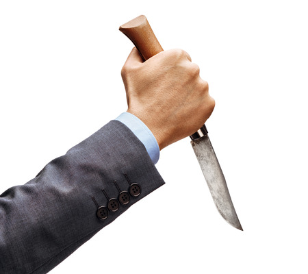 Mans hand in suit holding a knife isolated on white background. Close up. High resolution product