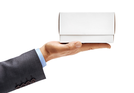 Man's hand in suit holding white box isolated on white background. Close up. High resolution product