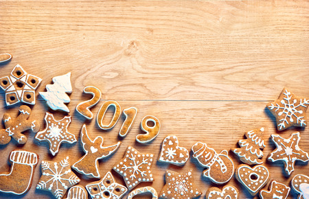Merry Christmas and Happy new year! Homemade ginger cookies on wooden table. Copy space for your text. Top view. Christmas baking concept