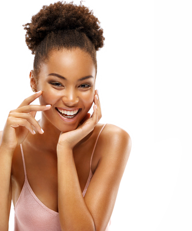 Happy smiling woman with natural makeup. Photo of young african woman on white background. Beauty & Skin care concept