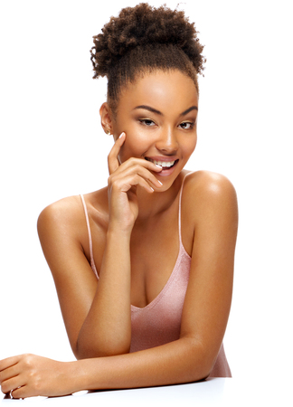 Smiling beautiful woman with natural makeup. Photo of young african woman on white background. Beauty & Skin care concept 写真素材