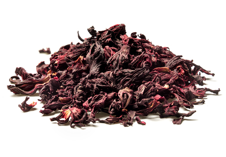 Heap of dried hibiscus petals on white background. Red tea, karkade. Close up. High resolution. Imagens