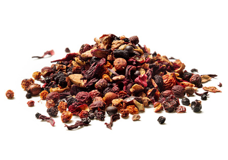 Heap of dried hibiscus petals and berries isolated on white background. Close up. High resolution.