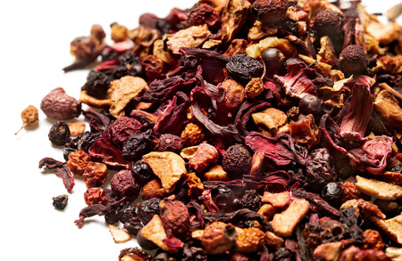 Karkade, red tea with berries on white background. Top view. Close up. High resolution