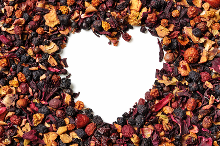 Heart shaped of dry hibiscus petals and berries on white background. Karkade, red tea. Top view. Close up. High resolution Reklamní fotografie