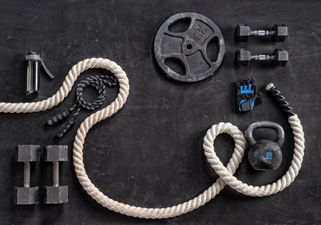 Sports equipment on a black background. Top view. Motivation Stock Photo