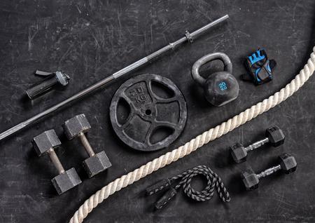 Sports equipment on a black background. Top view. Motivation Reklamní fotografie