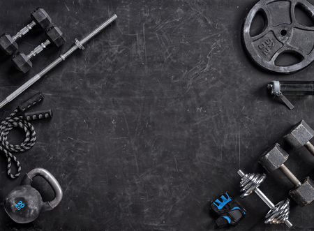 Sports equipment on a black background. Top view. Motivation Archivio Fotografico
