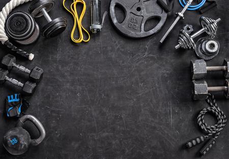 Sports equipment on a black background. Top view. Motivation Zdjęcie Seryjne