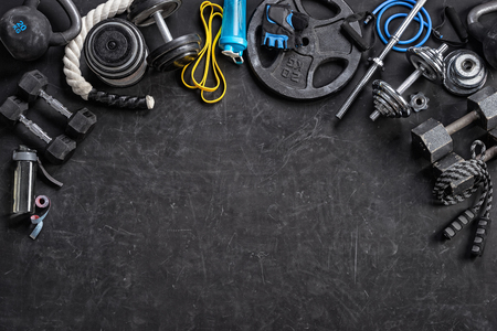 Sports equipment on a black background. Top view. Motivation 스톡 콘텐츠