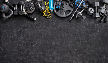 Sports equipment on a black background. Top view. Motivation Archivio Fotografico