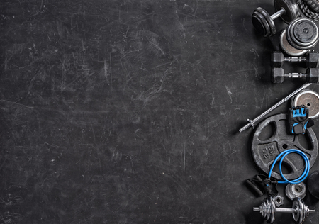 Sports equipment on a black background. Top view. Motivation Reklamní fotografie